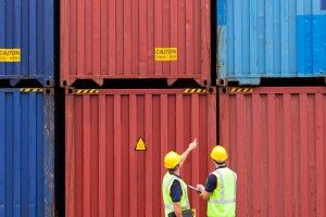 shipping containers two men pointing